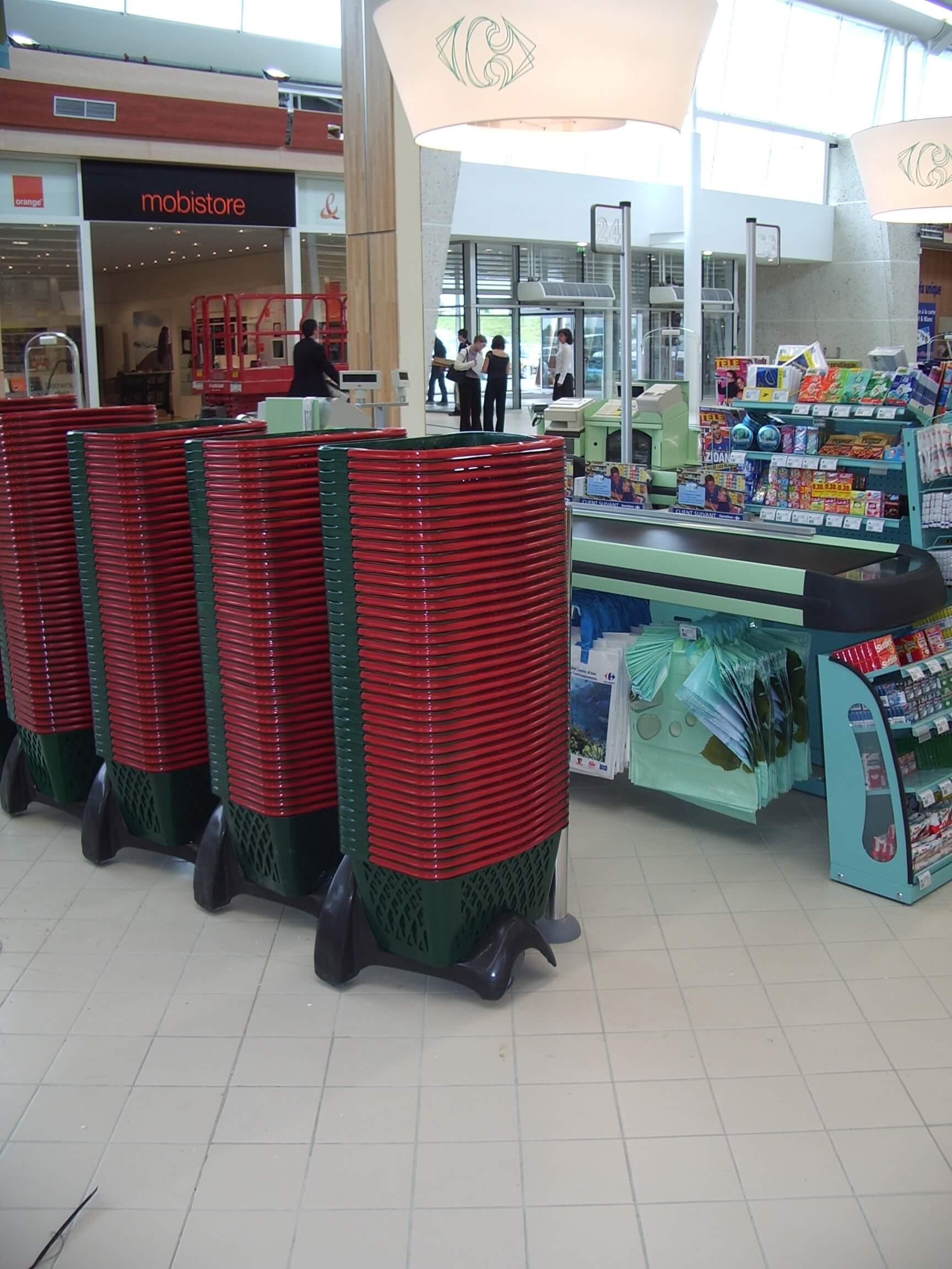 Shopping Baskets Stacked on Wheeled Holder
